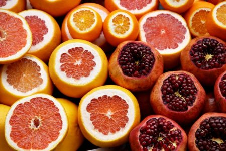 Sliced grapefruit, oranges and pomegranites