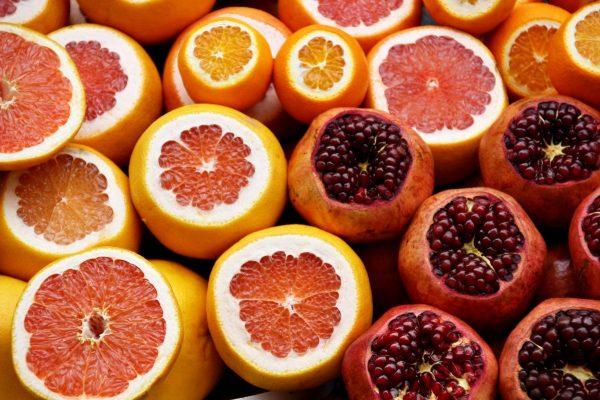 Sliced grapefruit, oranges and pomegranites