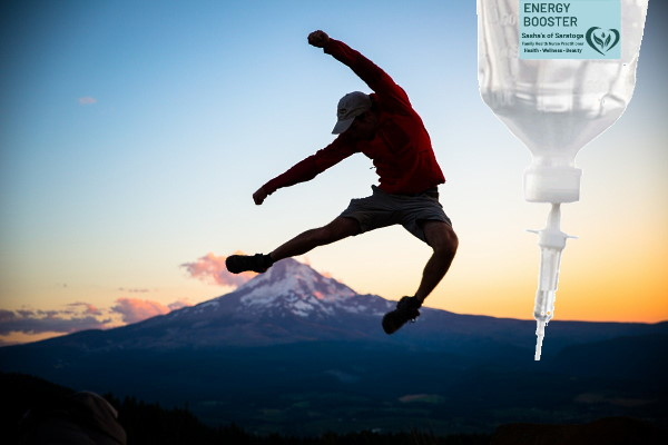 Energy Boost - man leaping into air in front of mountain