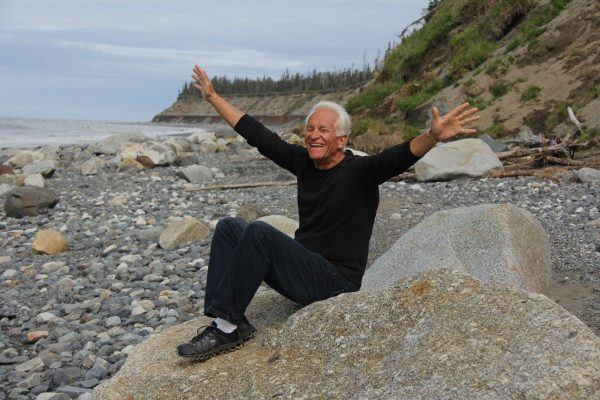 Happy older man with outstretched arms