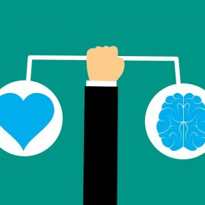 Arm holding out pictures of heart and brain