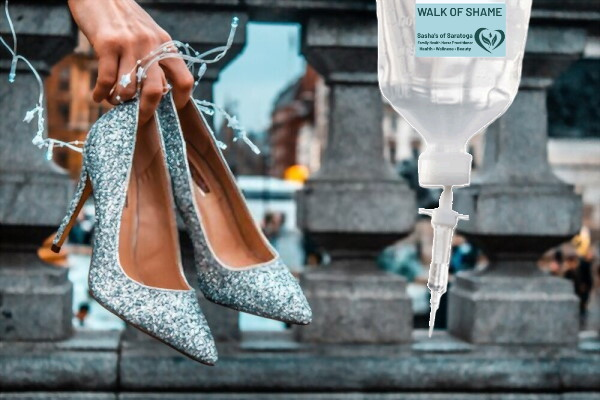 Walk of Shame (Hangover Cure) - hand carrying pair of high heels with IV bag hanging into picture