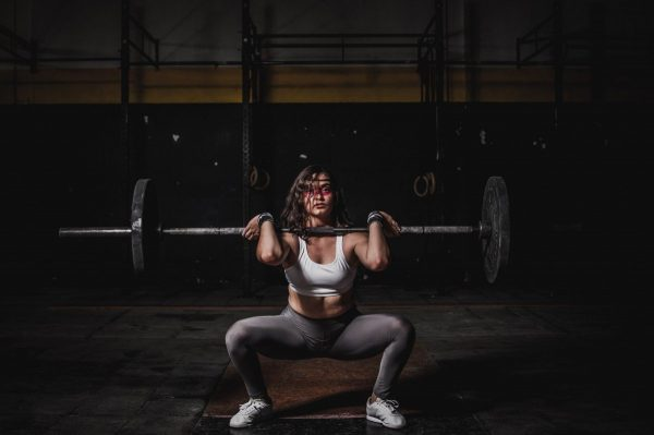 Woman squatting and lifting weights
